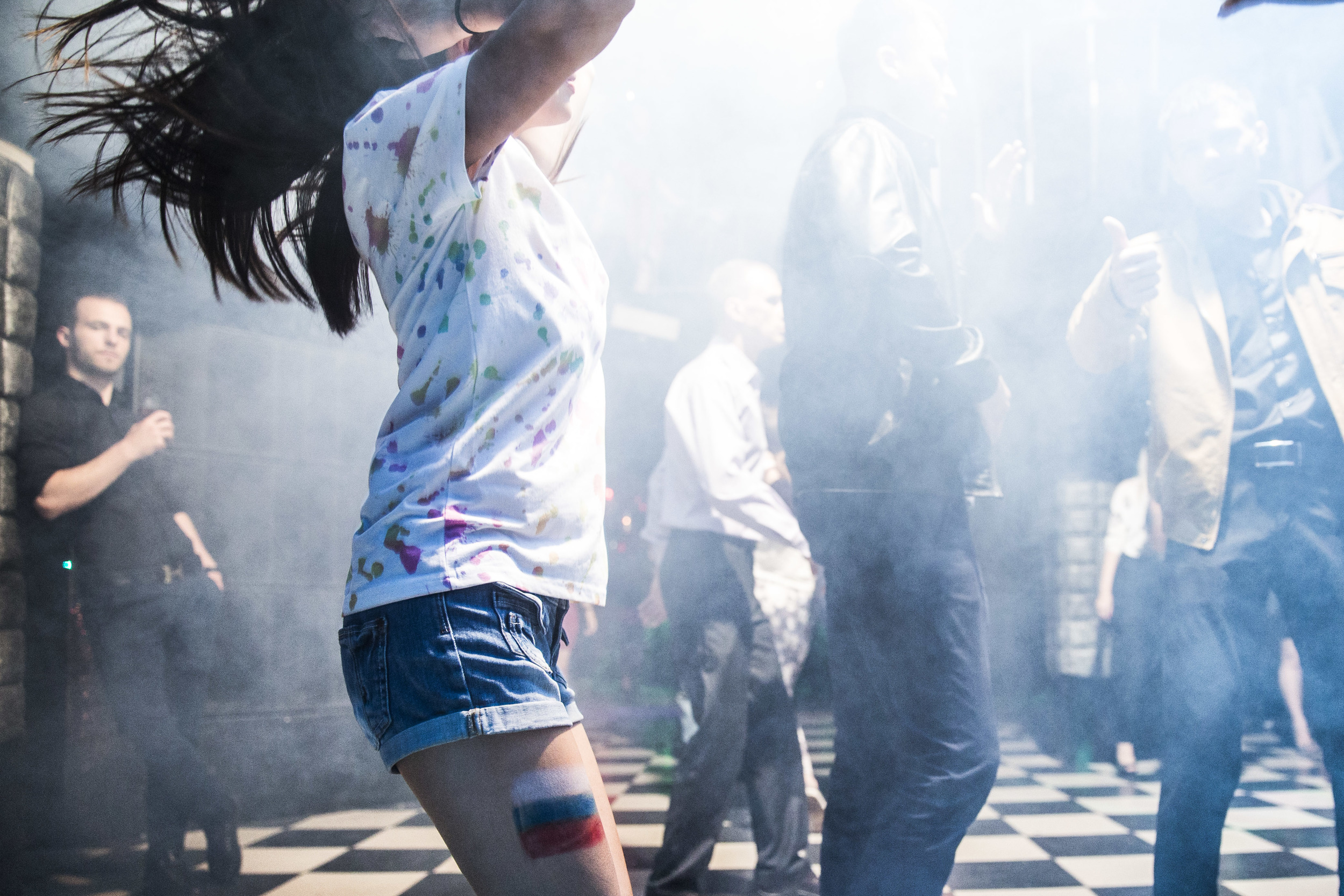 Woman with a national flag painted on her leg parties on Russia day in London club in Moscow