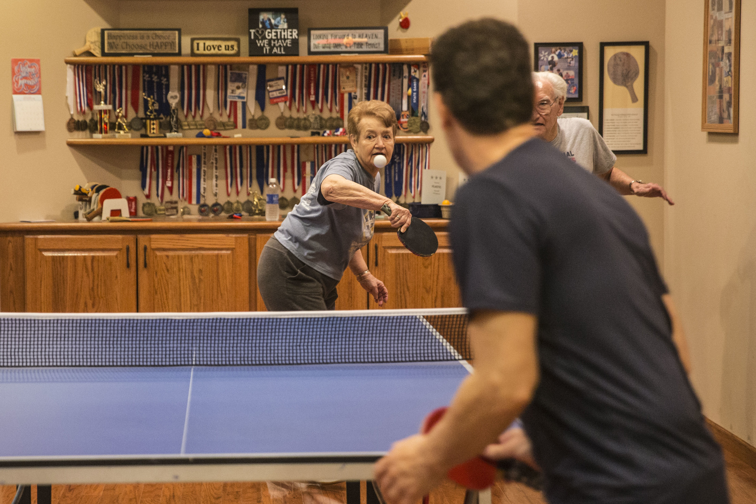Jared & Leia play table tennis at their house's basement