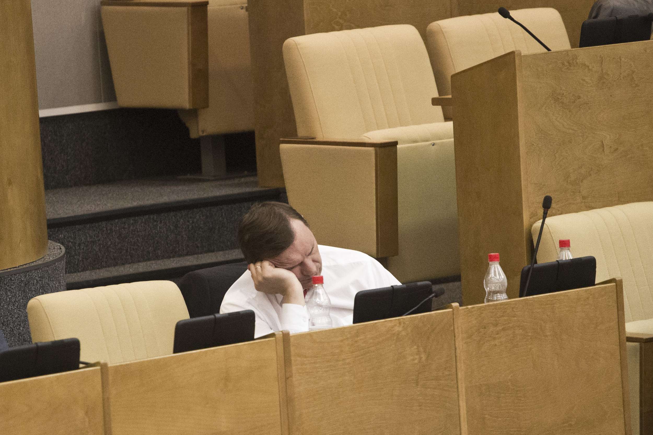 A member of Russian parliament sleeps during a session. June 5, 2012