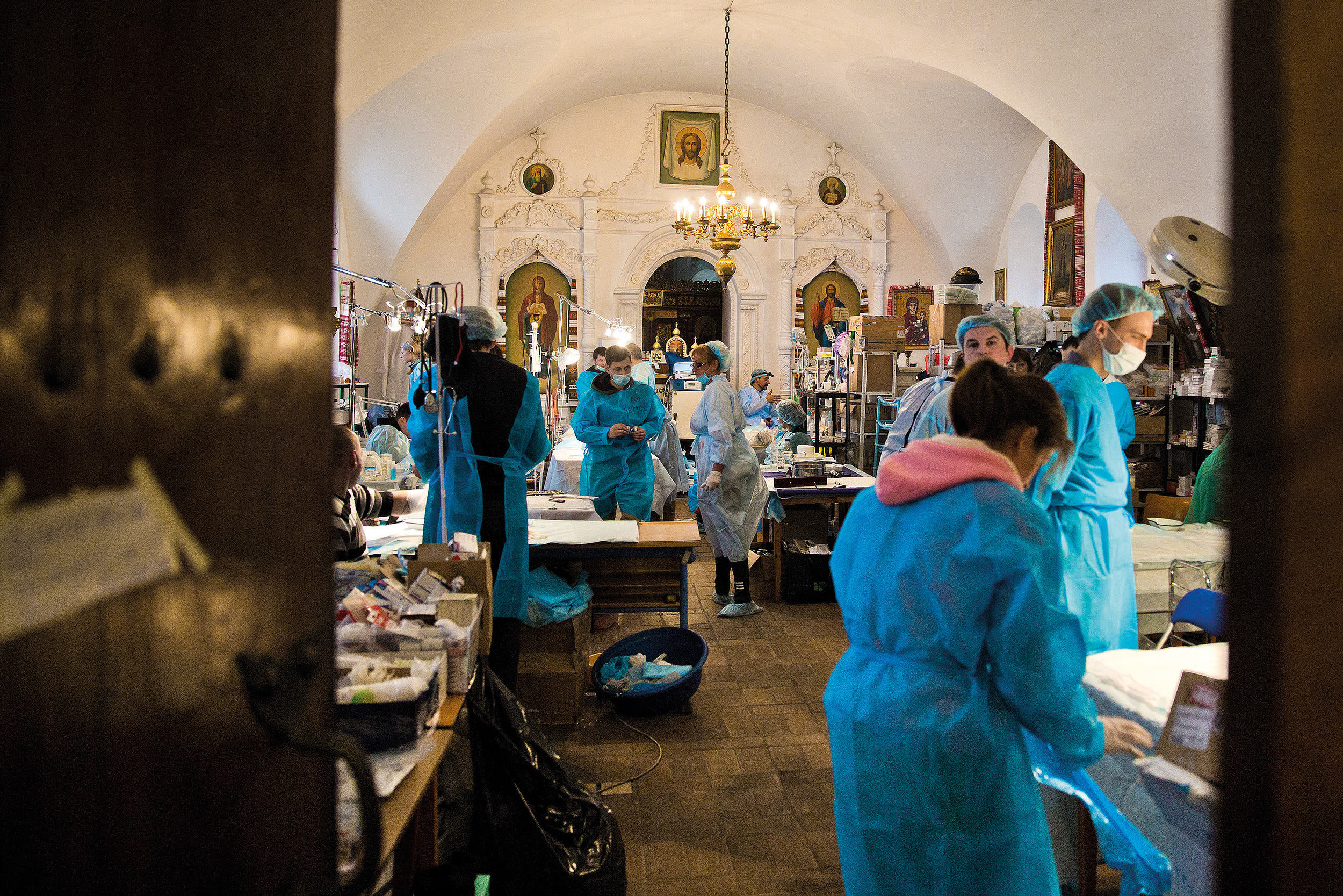 Volunteers help as doctors in the hospital organized in Kyiv's Mikhailovsky monastery after almost 100 protesters were killed with snipers' fire and hundreds were wounded