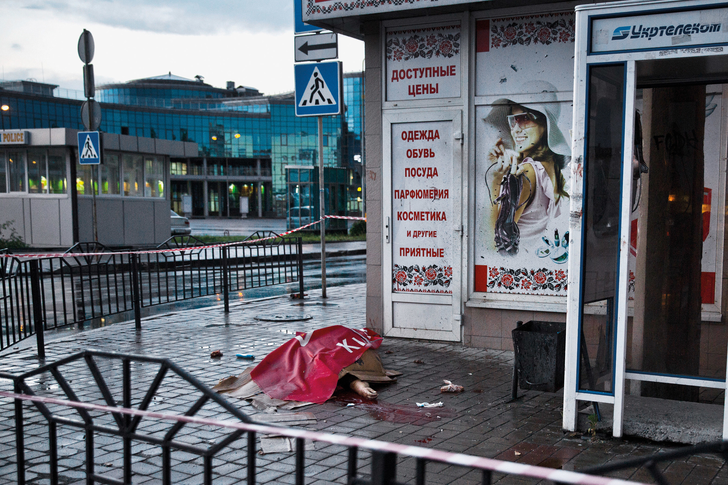 A civilian woman is seen dead in Donetsk