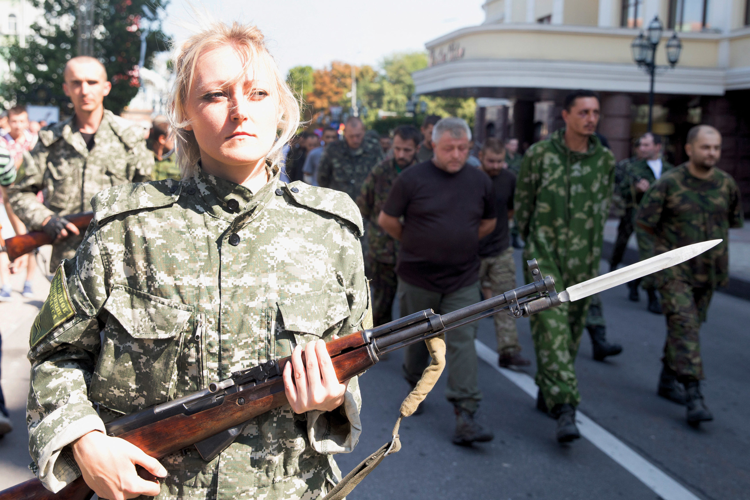 Pro-Russian fighters are seen escorting Ukrainian POWs on the streets of Donetsk