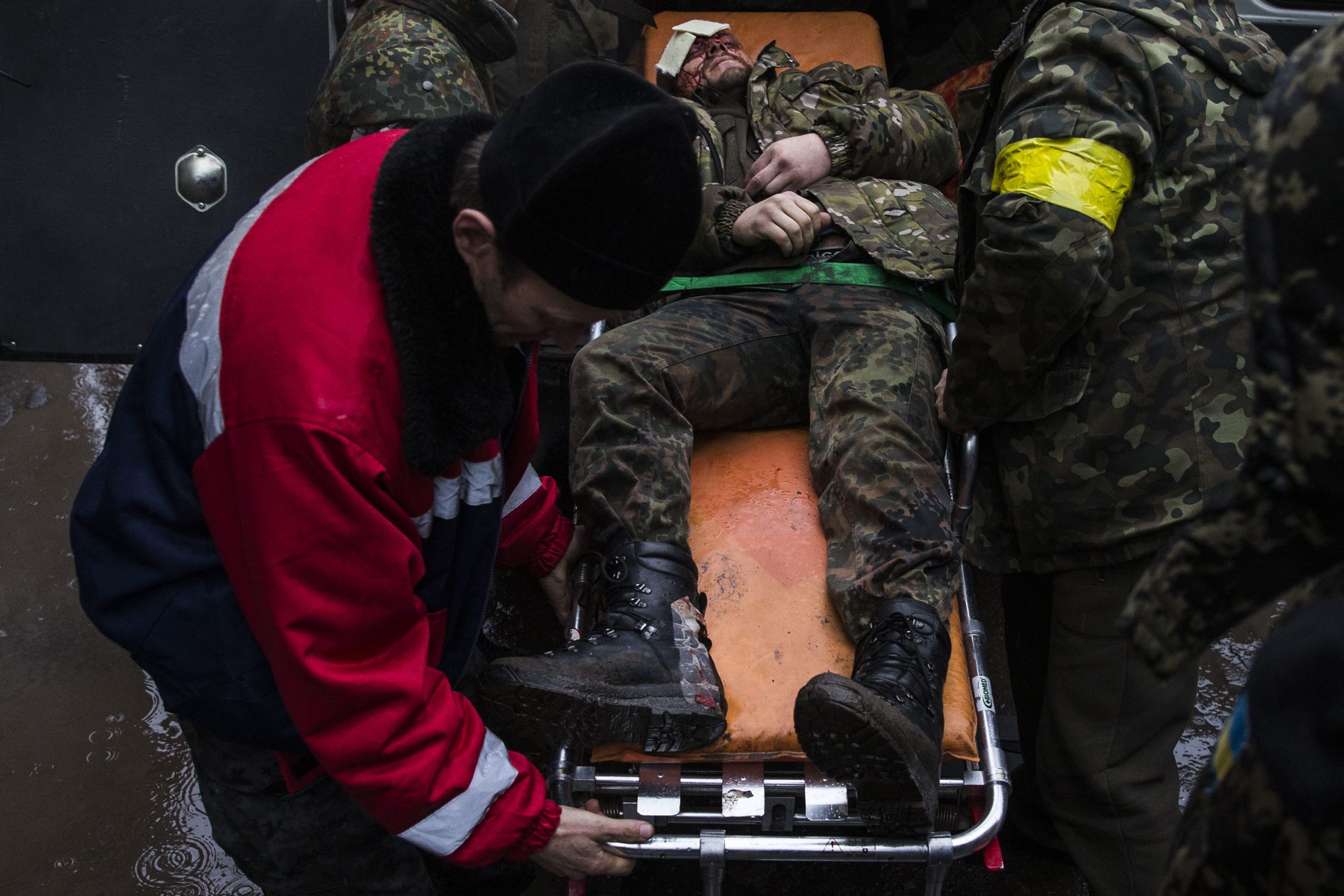 Ukrainian soldier is seen wounded as he is transferred to the hospital after fights in Debaltsevo area