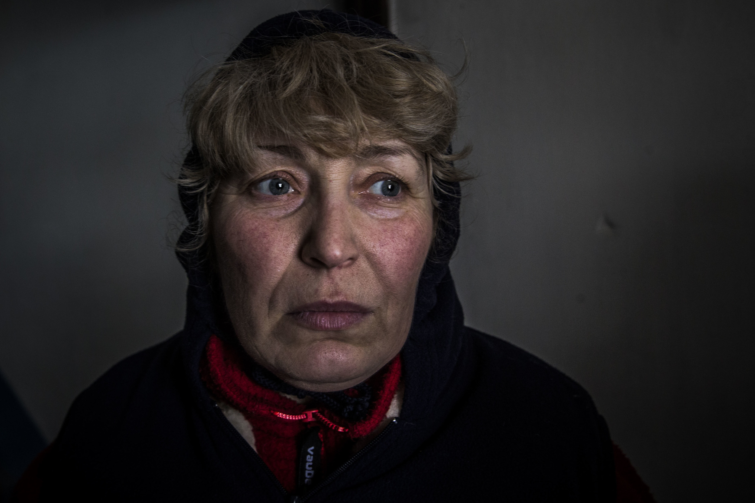 A woman is seen hiding in a basement as Debaltsevo comes under heavy fight from separatists' side