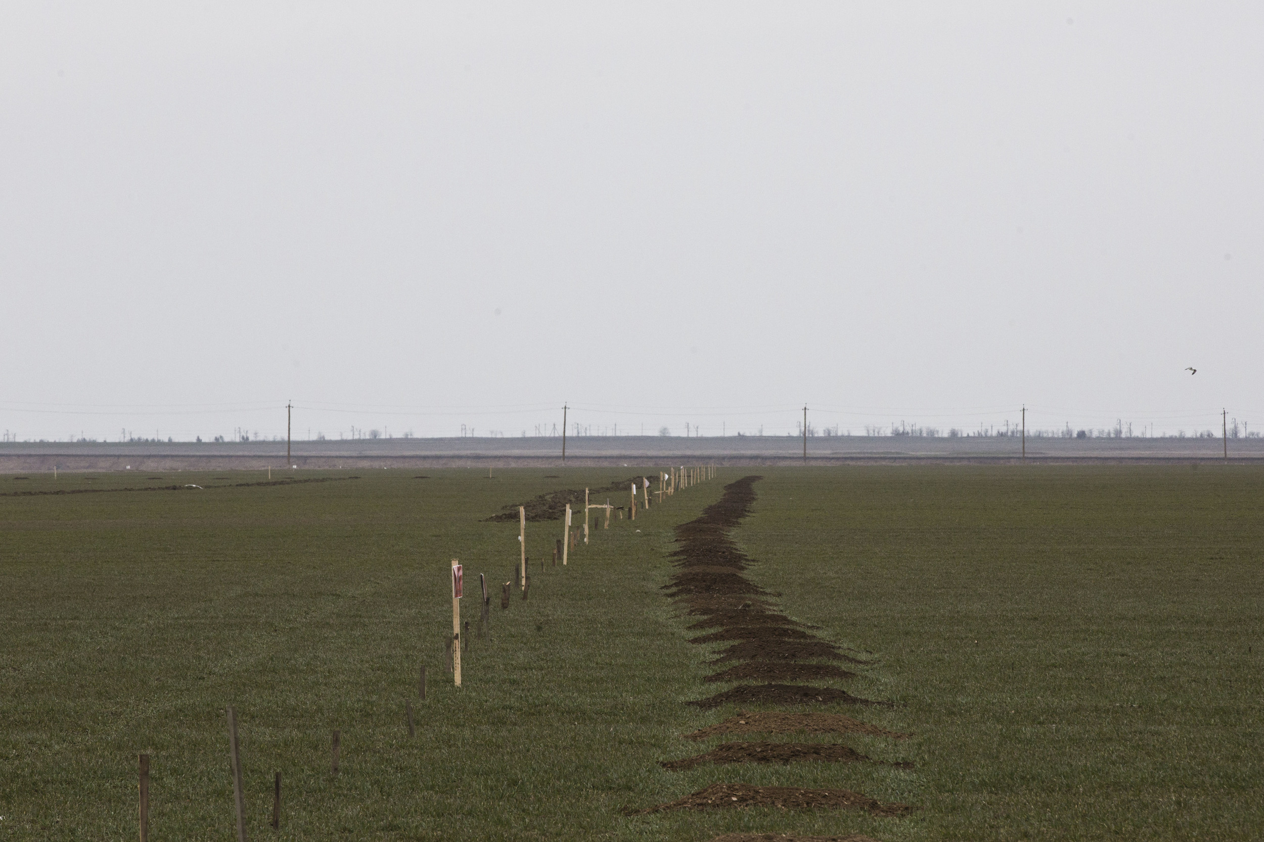 Minefield and a border line are prepared by Russian soldiers in Ukrainian region Kherson next to Crimean peninsula