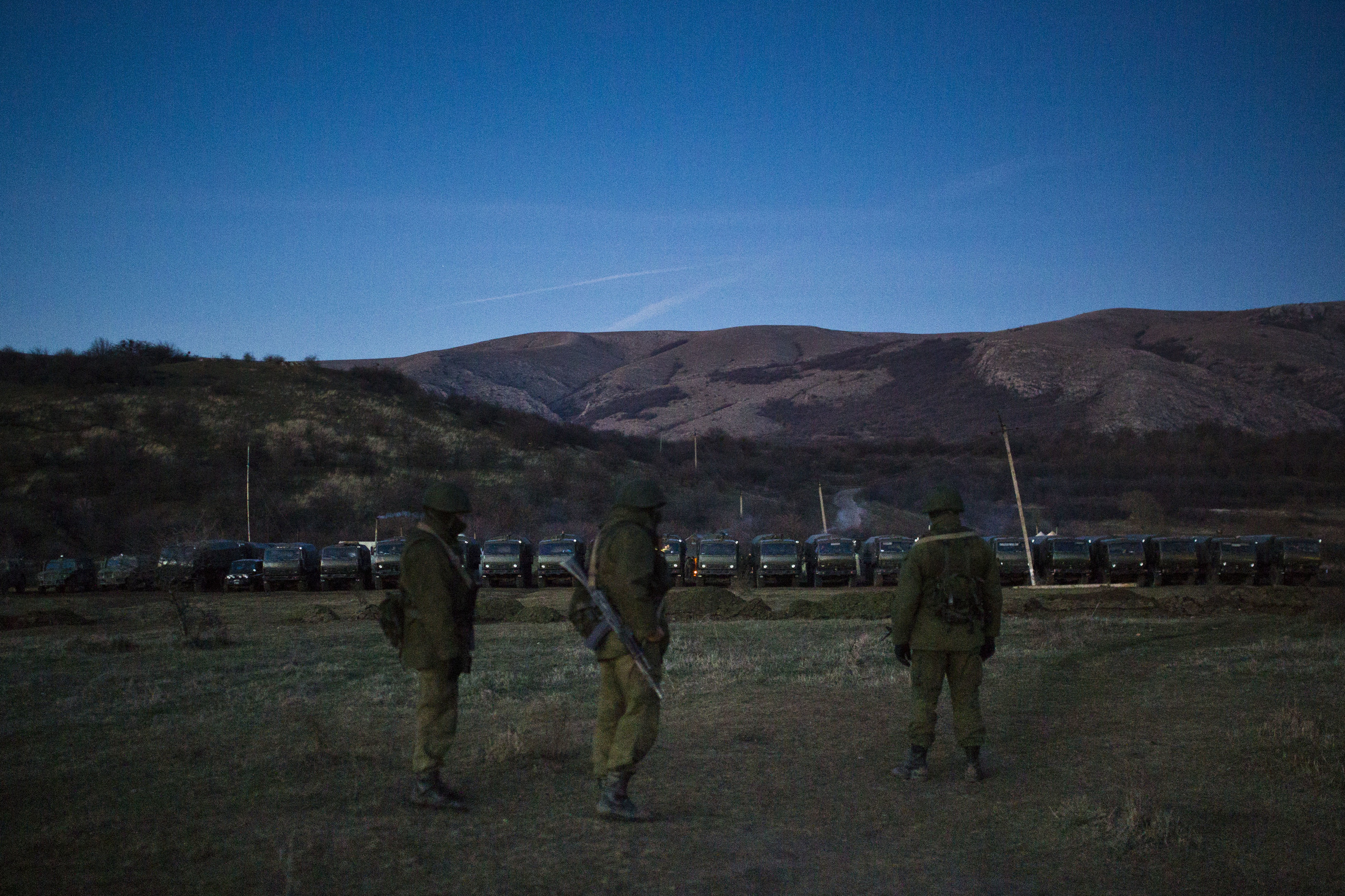 Russian soldiers are seen guarding their camp that blocked one of Ukrainian army military bases in Crimea