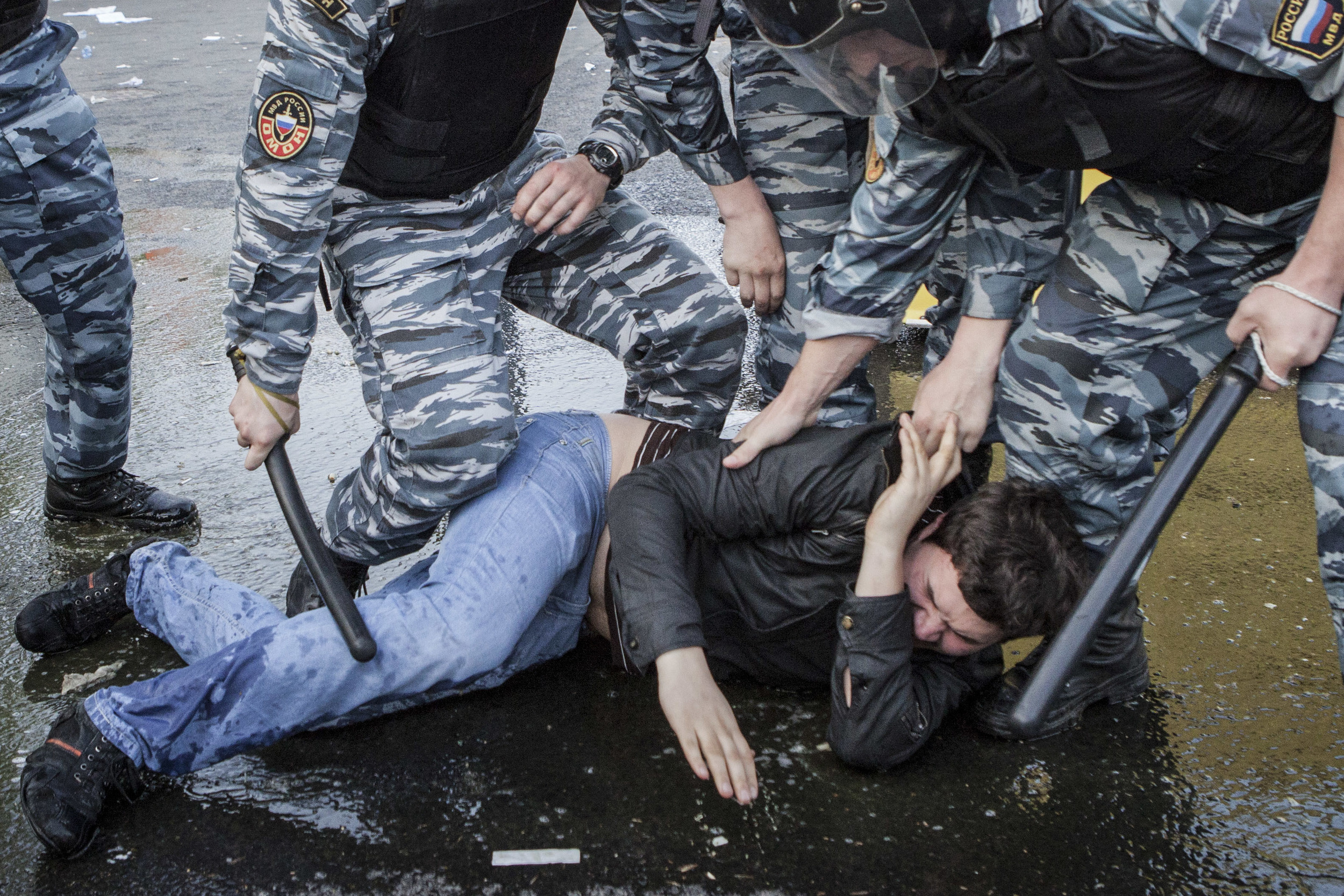 Riot Police detain and beat an activist after the protest rally was stopped and turned into riots that were dissolved. Thousands were arrested. May 6 2012
