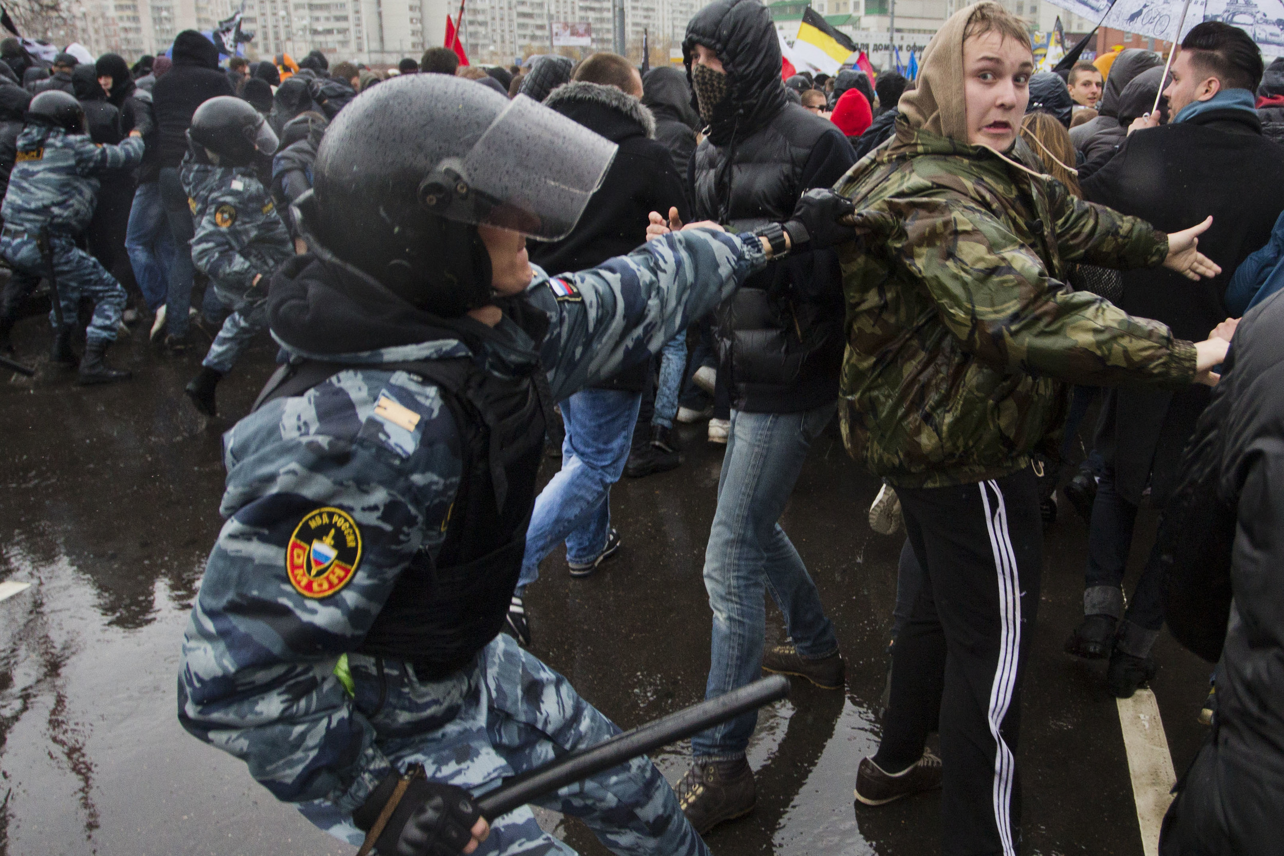 A policeman arrests a right-wing participator in nationalist Russian march rally. November 2013