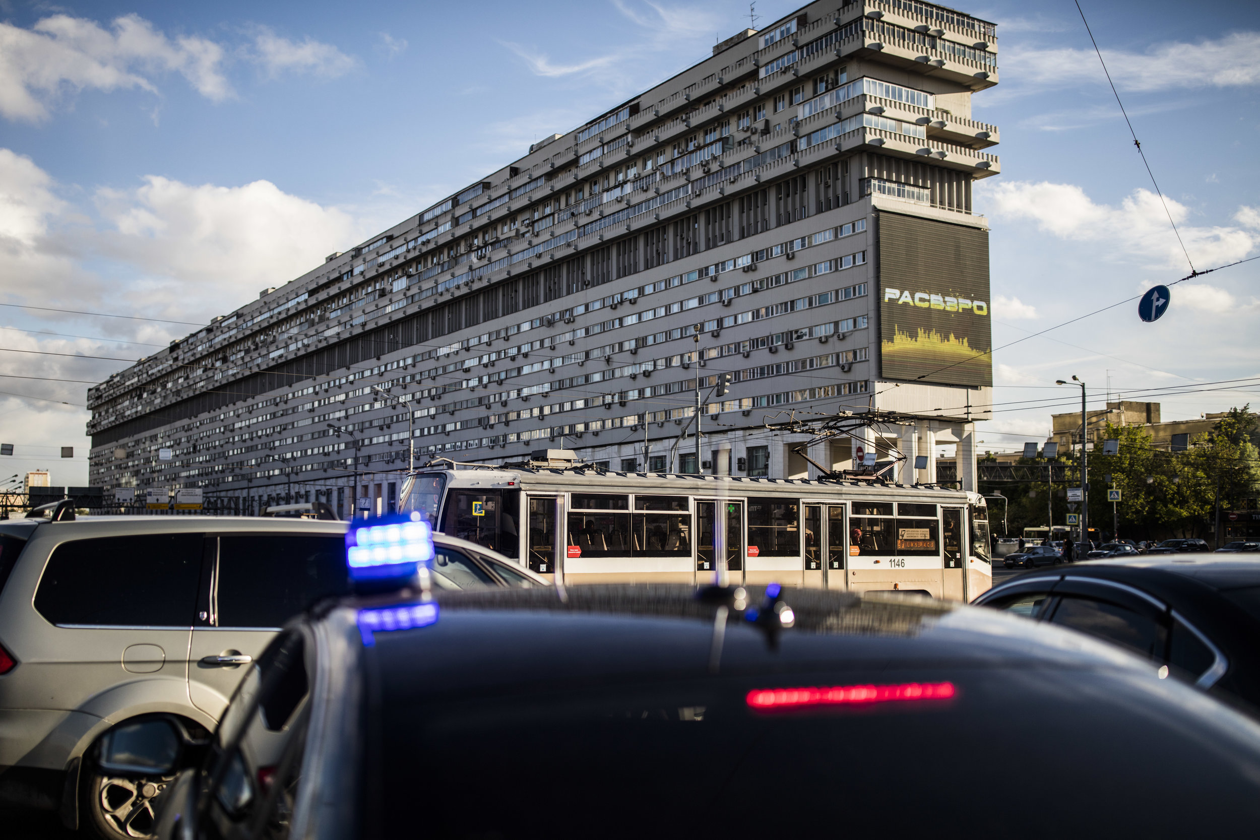 'Ship-house', a legendary half-a-kilometer-long brutalist apartment building that was used to accomodate scientists working on nuclear energy programs, is now completely changed and somewhat damaged by capitalism.