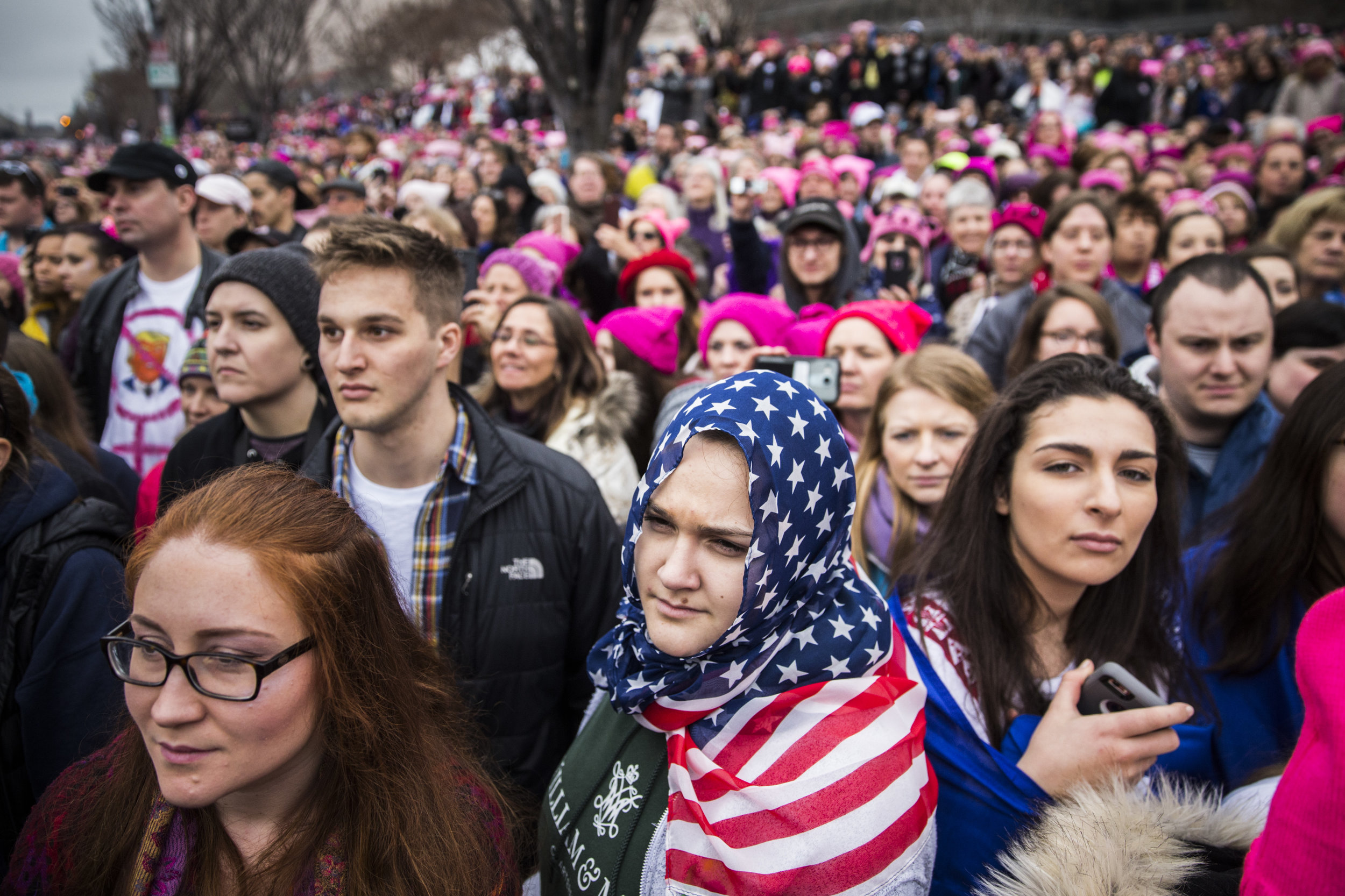 A protester wearing an American flag as a hijab stands amidst the crowd at Women's March on Washington