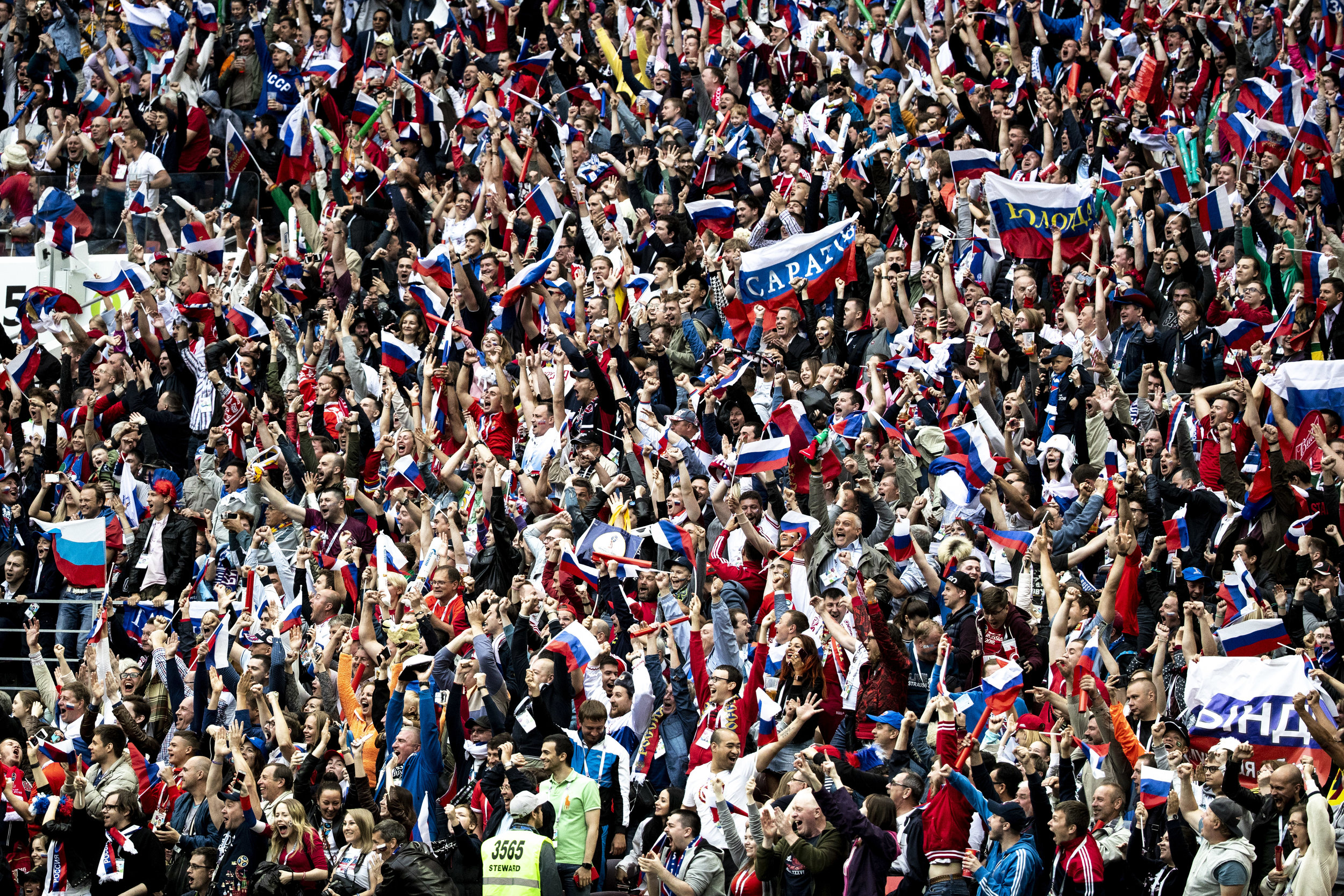 Russian fans celebrate their team's second goal against Saudi Arabia in the World Cup opening game in Moscow