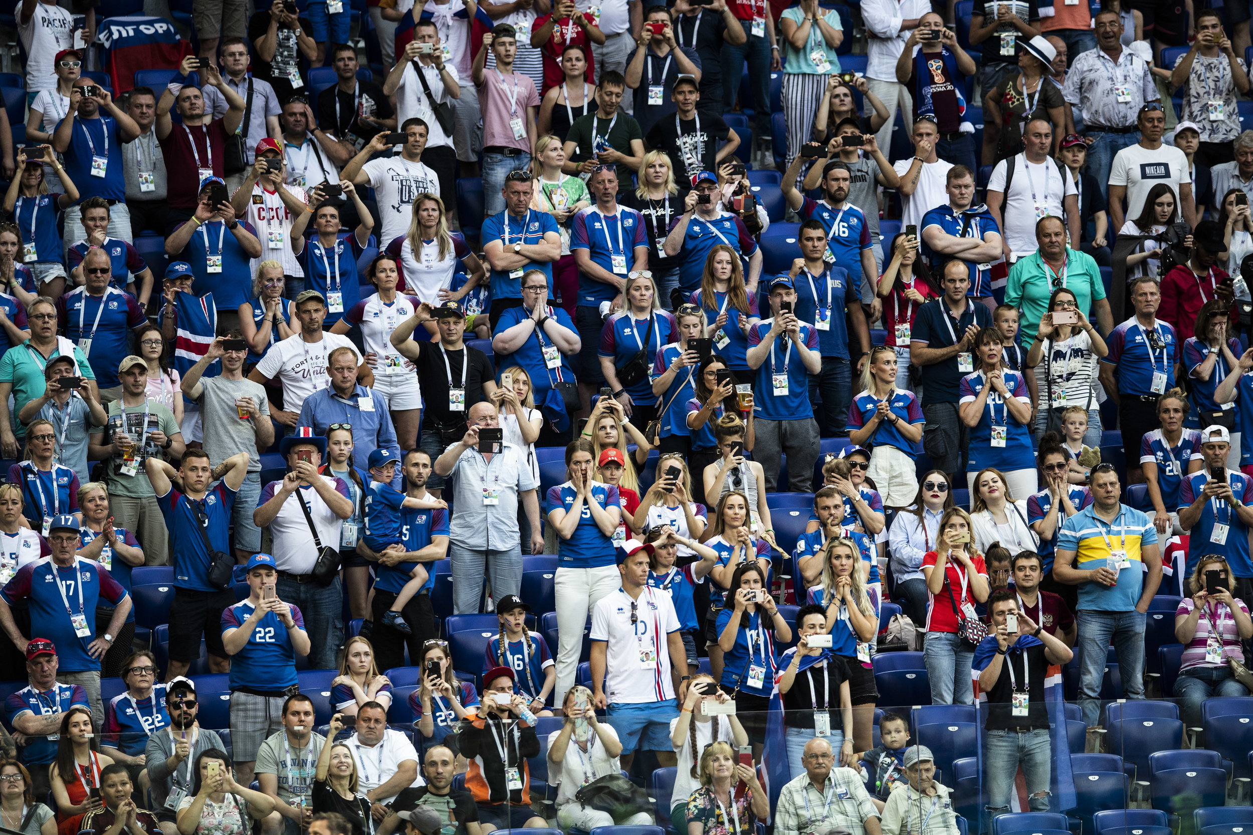 Icelanders react as their team is awarded with a penalty kick during a game against Nigeria in Volgograd