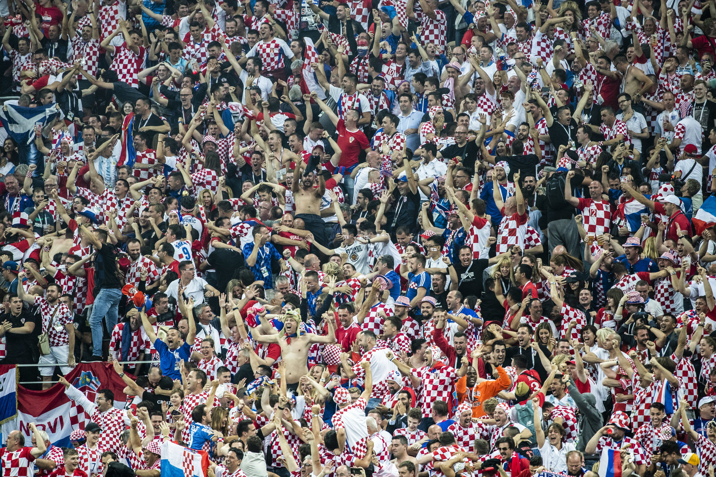 Croatians cheer as their team continues to attack after scoring a late goal during additional time in a semifinal game against England in Moscow