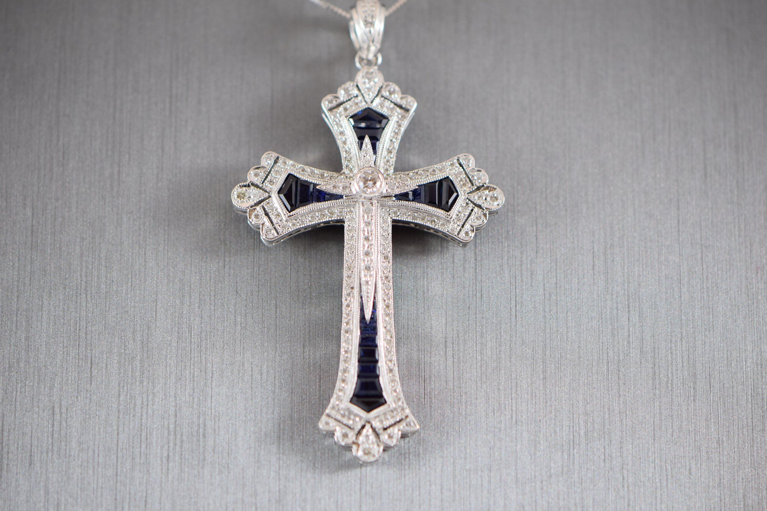 Sapphire and diamond cross pendant