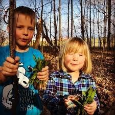 My two kids, wild leeks in hand.
