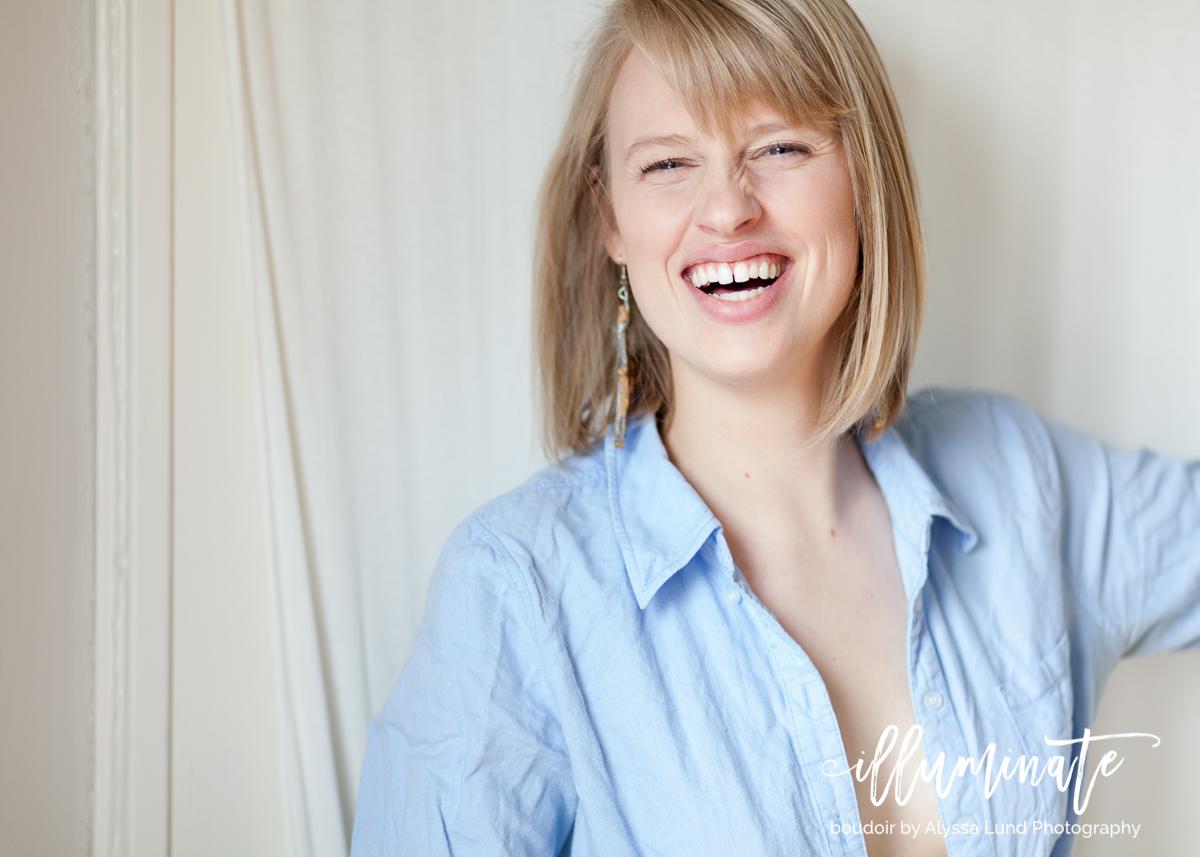 Laughing, elegant Minneapolis boudoir portrait