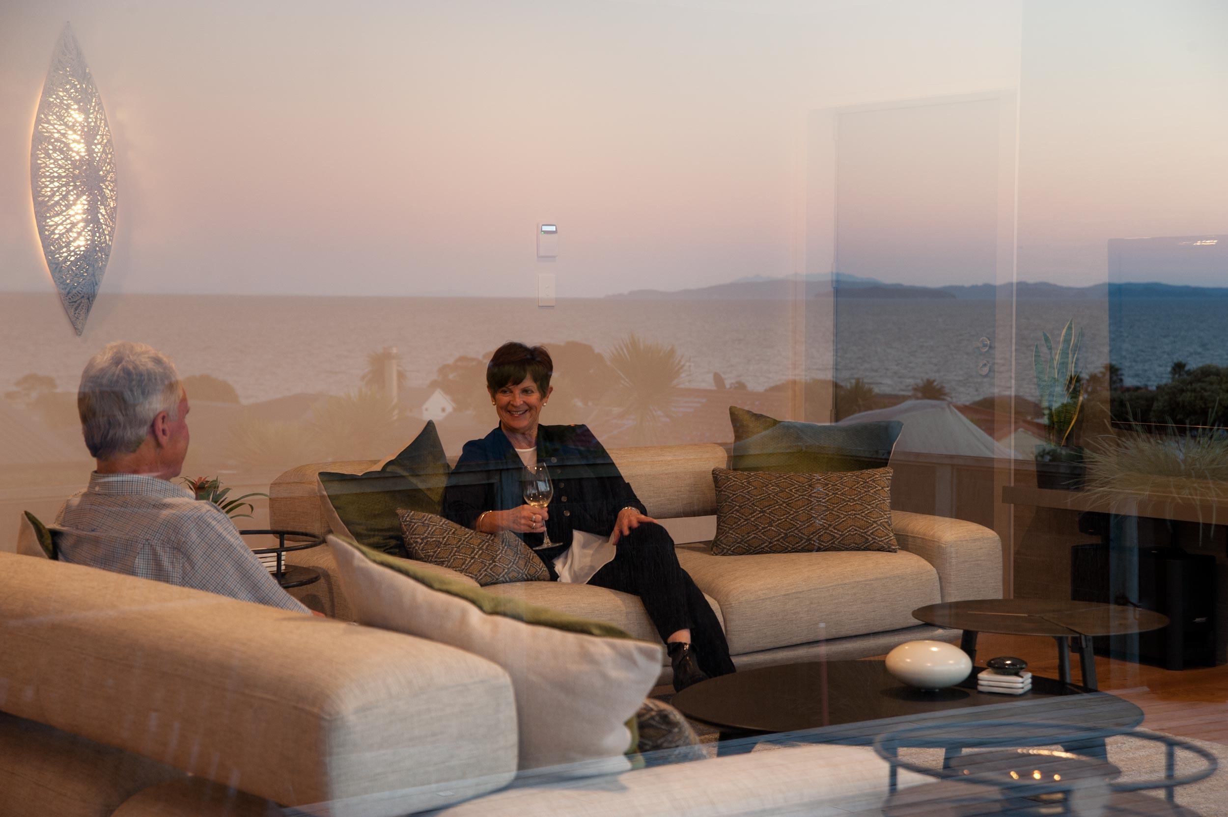 Kirsten Ford Design renovation red beach sofa living room