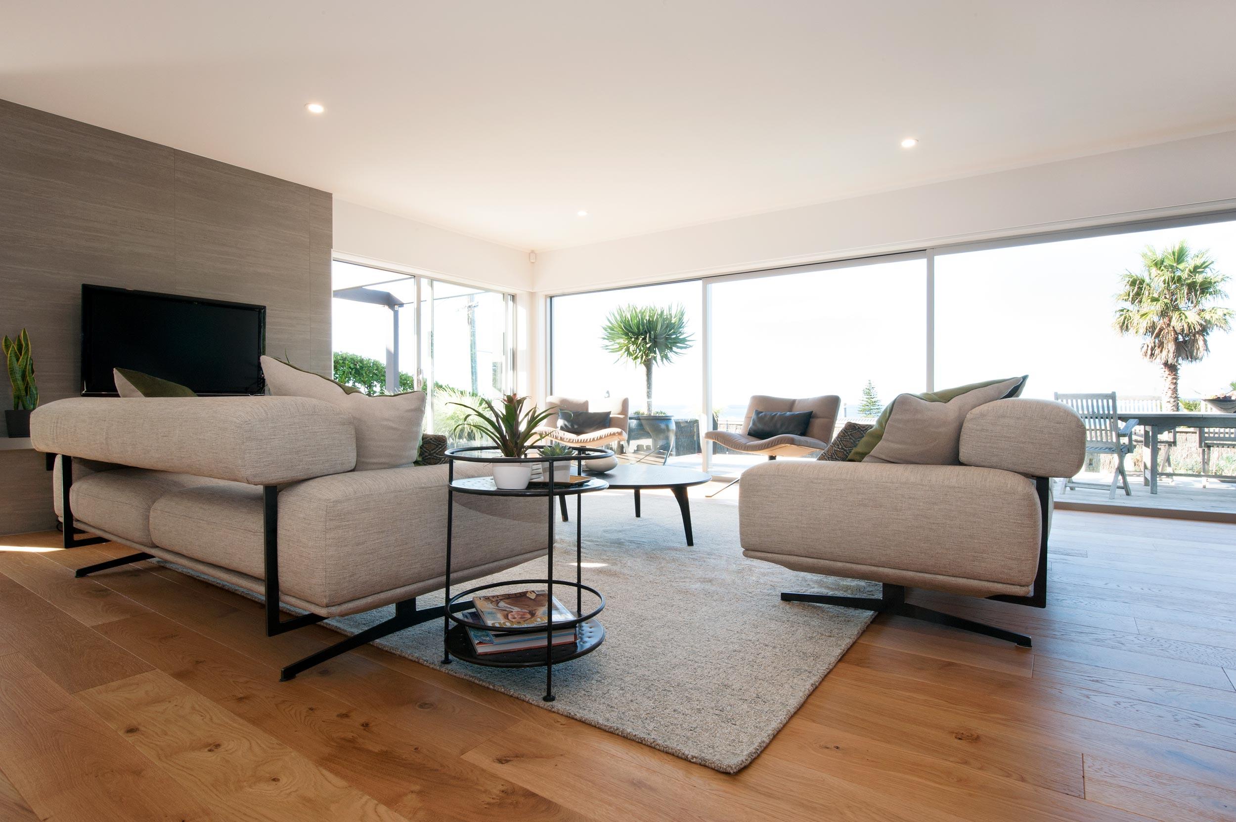 Kirsten Ford Design renovation red beach sofa