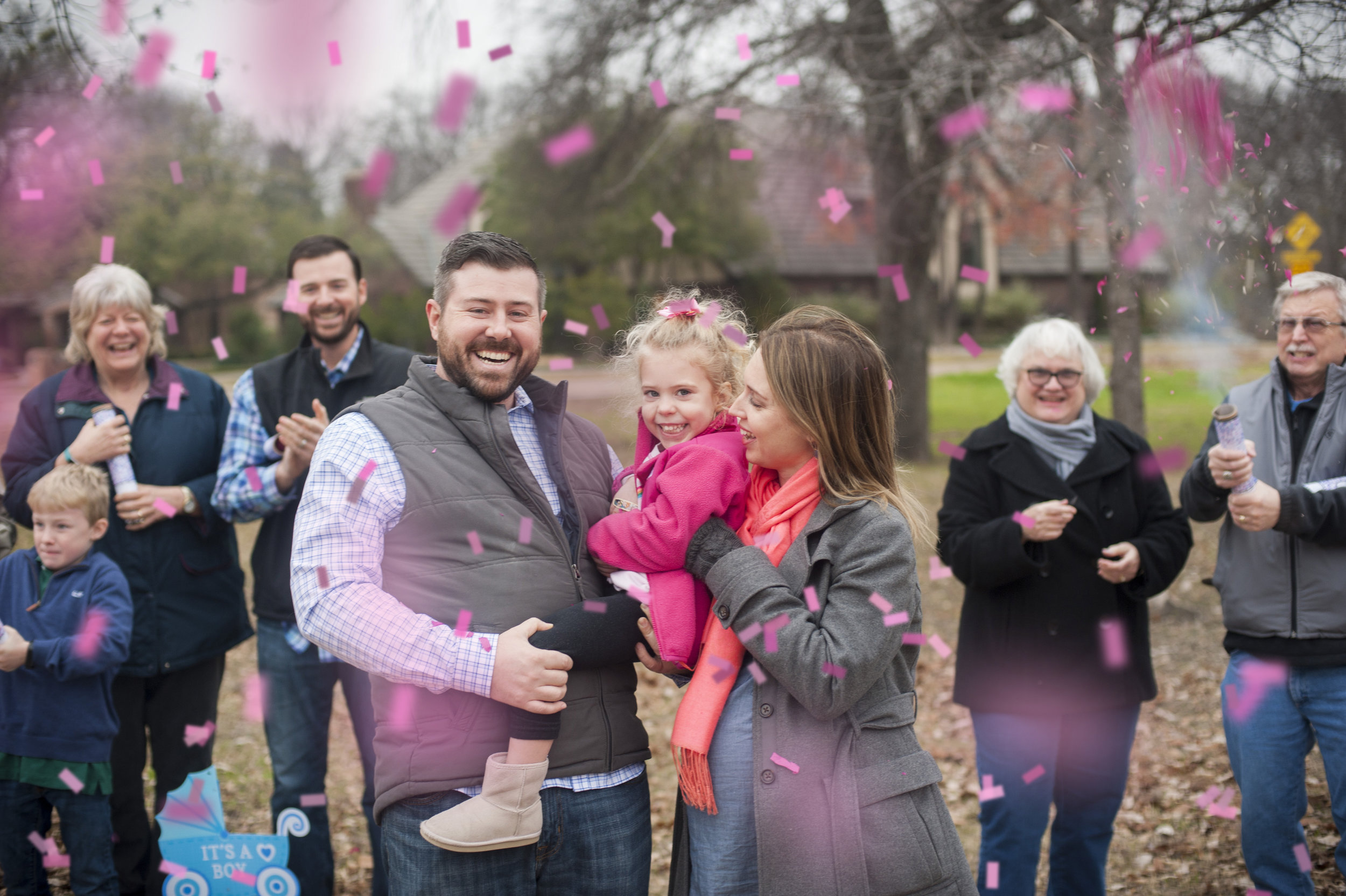 Confetti cannon gender reveal with the entire family. It's a girl!