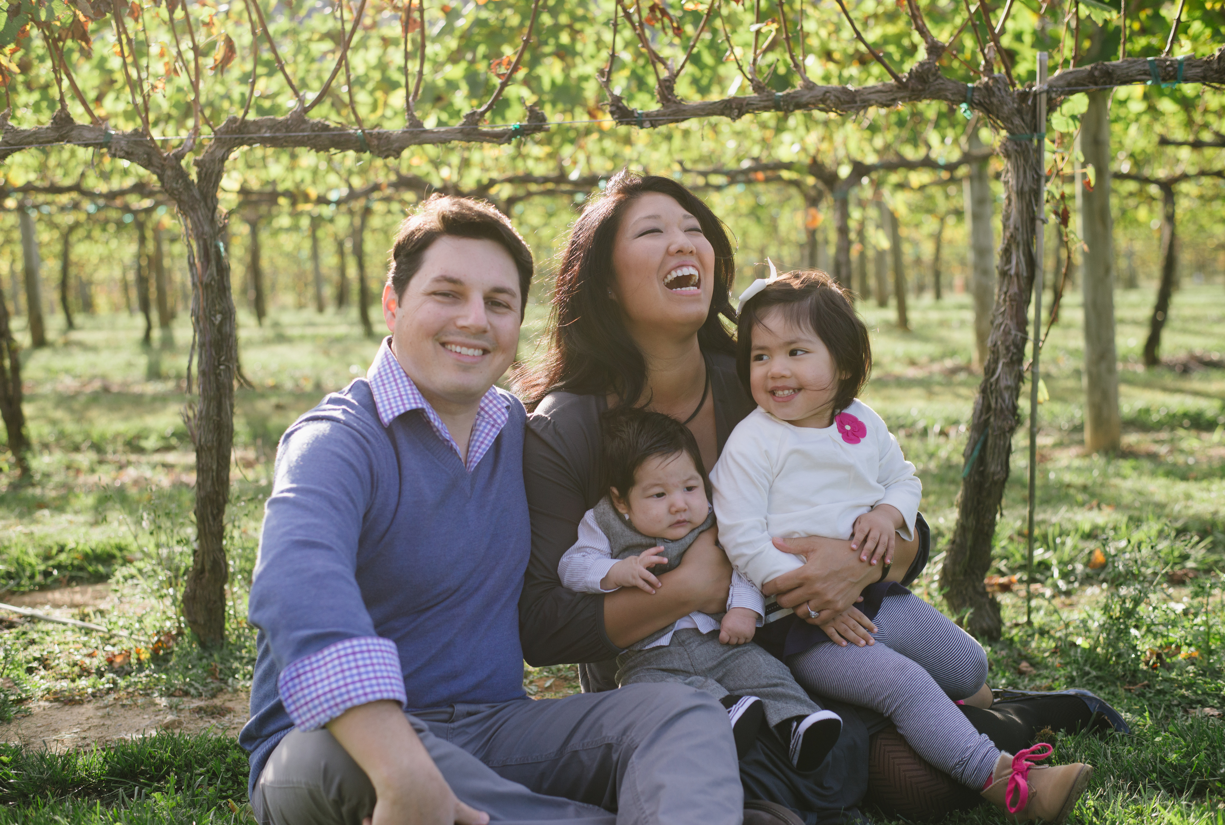 Family laughs together during their session outside a vineyard near Northhampton.