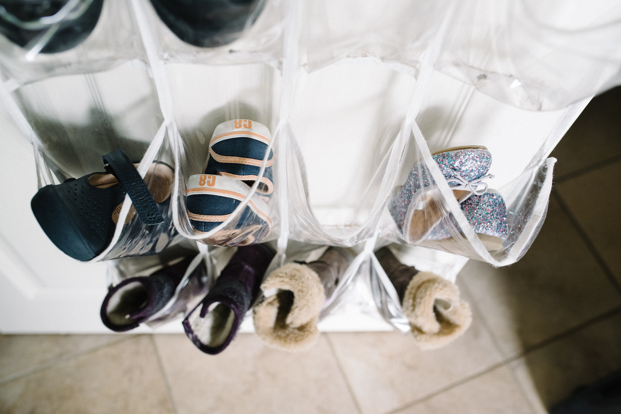 mom hacks, closet storage, shoe storage, winter gear storage, stay organized with children