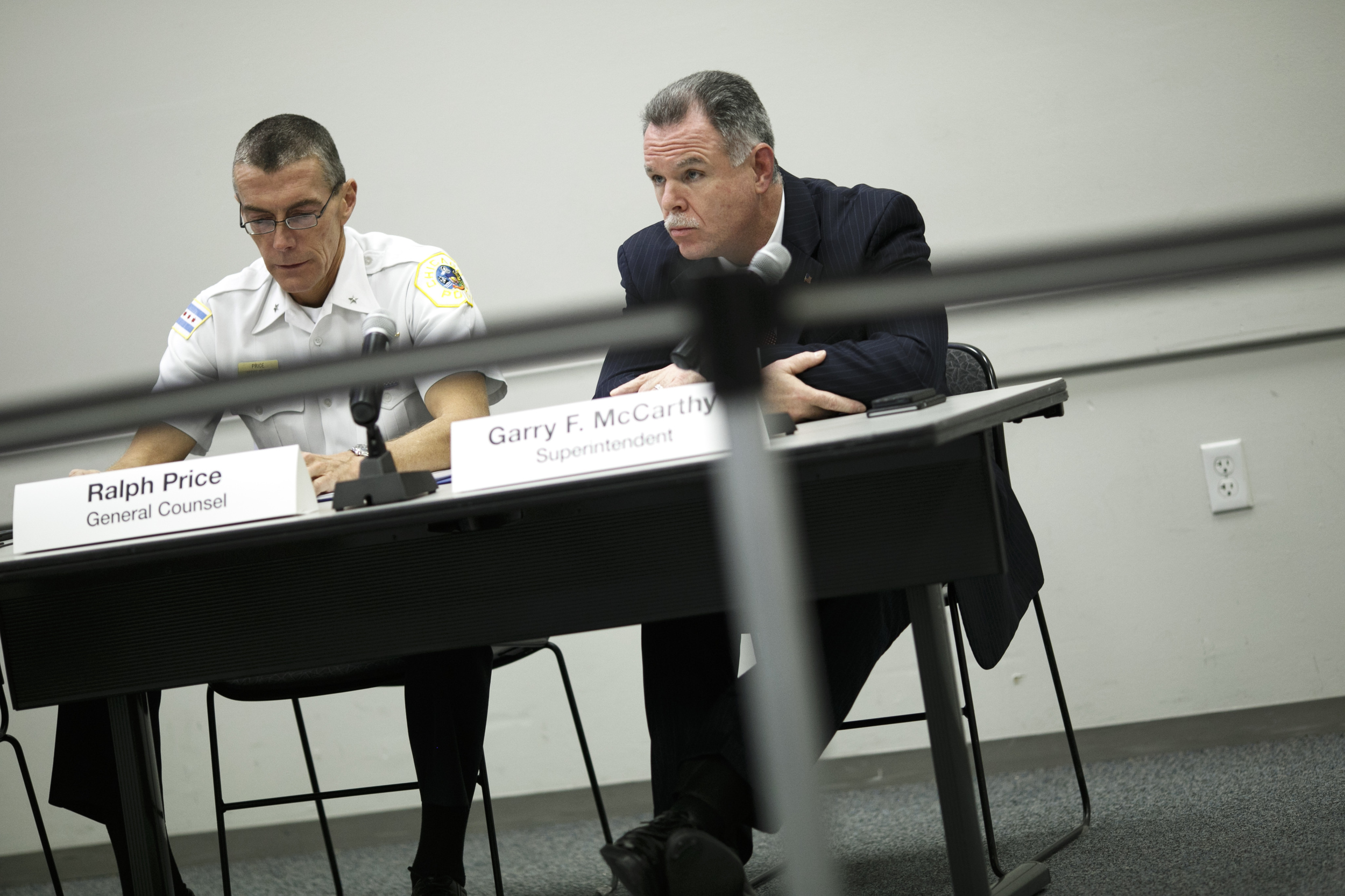 The Chicago Police Board votes during its November 19 meeting (Jonathan Gibby/City Bureau)