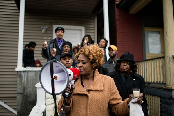 Evelyn Glover-Jennings cousin of Bettie Jones, holds a prayer with her family and elective officials of the west side of Chicago on Sunday December 27, 2015. (William Camargo/City Bureau)