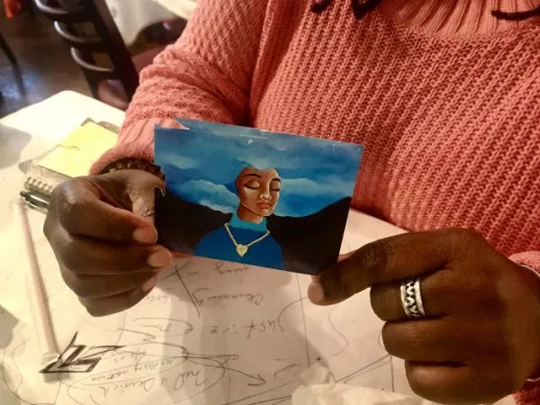 "Cheryl Graves carries this image in her purse everywhere she goes. The art was created by a young man she sat in circle with named Ty. ""I think he did this piece about his mother,"" Graves explained. ""Because she dreams big dreams for him. It's just like when you're sitting in circle with people you don't know. What's the point if you don't believe in big dreams, that things can change and be better?"" (Photo: Jenny Simeone-Casas)"