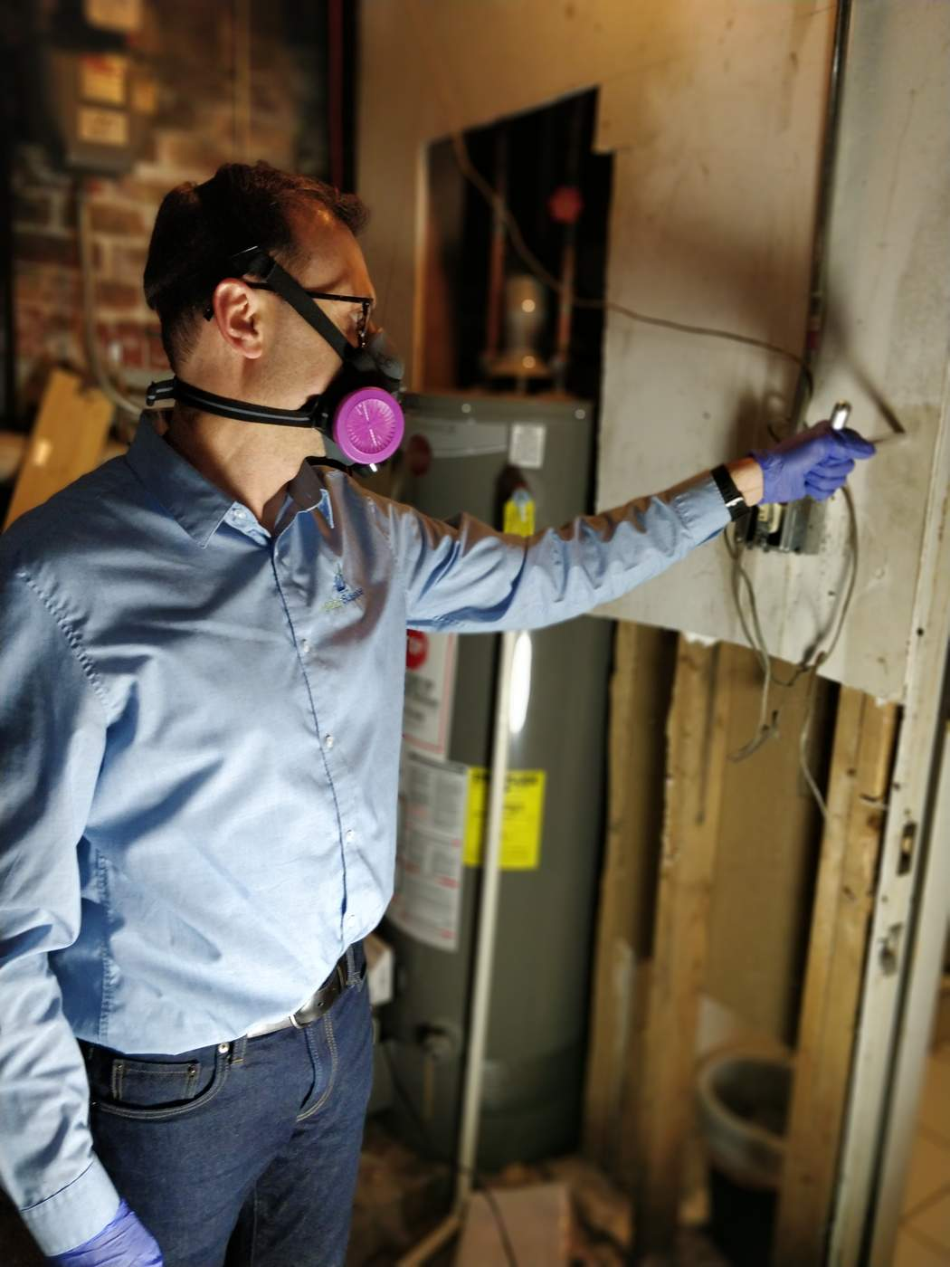 Environmental consultant Ian Cull inspects for asbestos at a client's home (Courtesy Indoor Sciences, Inc.).
