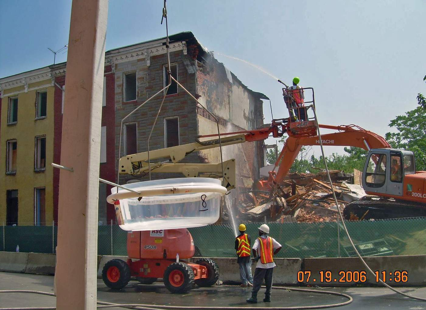 A research team uses a lead dust fall sampling apparatus to measure lead levels in the air during a demolition in Baltimore. (Courtesy  David Jacobs )