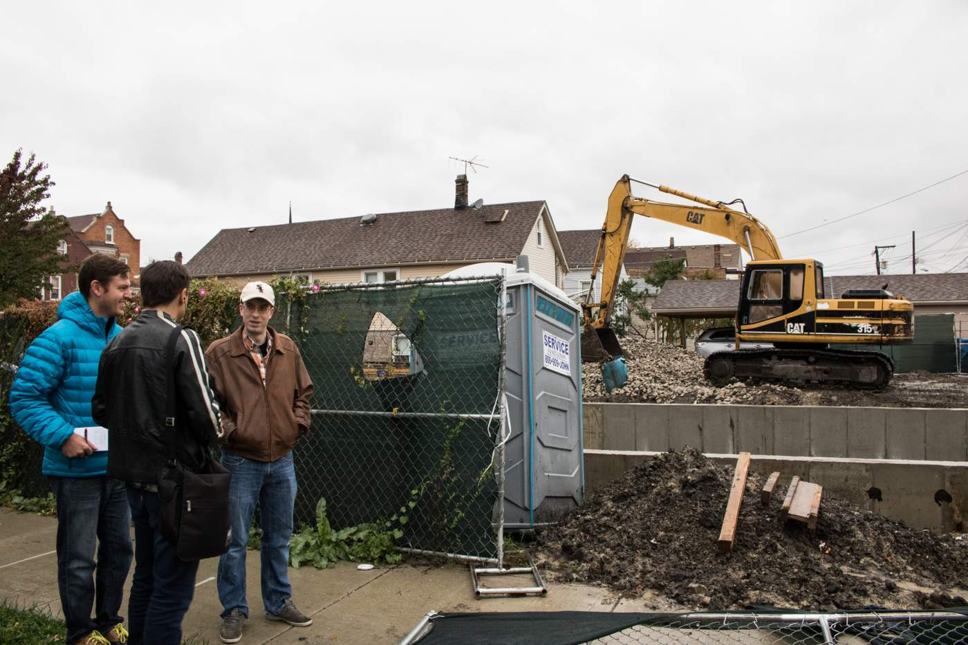 Robert Beedle (right) visited the demolition site that inspired his question alongside  Curious City  audio producer Jesse Dukes (middle) and  City Bureau  reporter Jeremy Borden (left). (Photo: Manny Ramos).