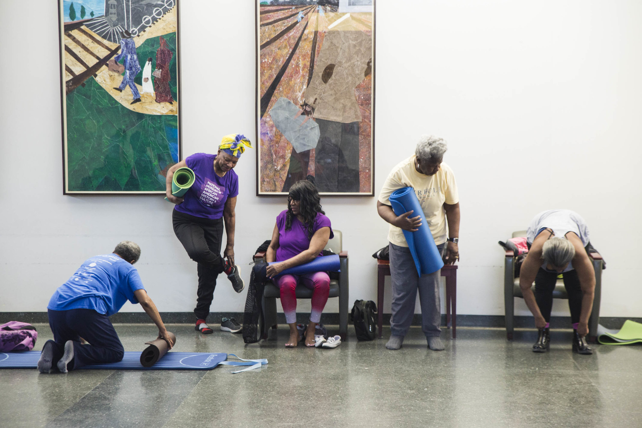 Older adults attend a free yoga class taught by Tony Stevens in the senior satellite in Abbott Park in Roseland.