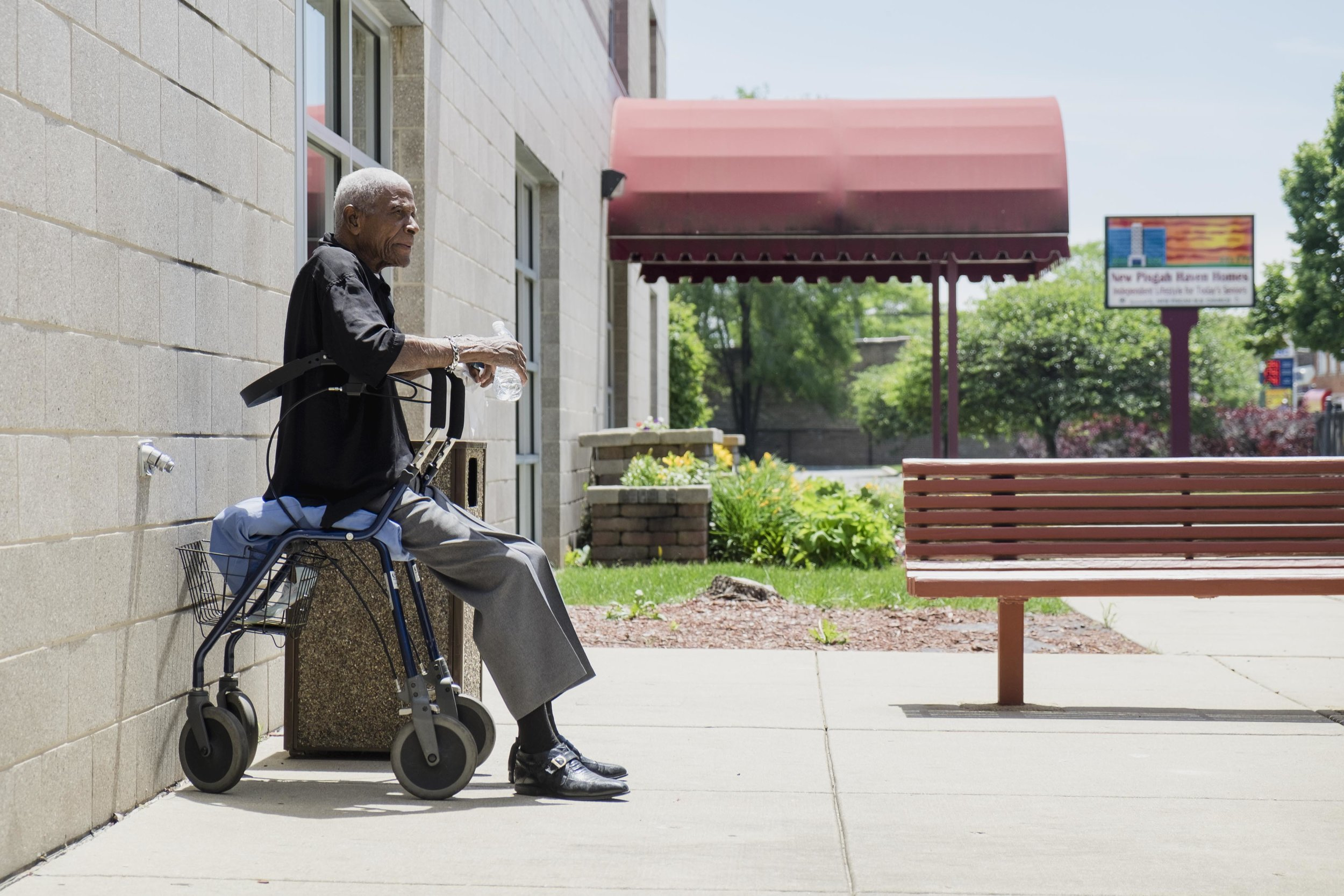 """Joe Boyd, 82, gets some sunshine outside the senior building he lives in in Auburn Gresham. """"A lot of times as you get older, [people] leave you, you know what I mean? One by one,"""" said Boyd, a veteran who often reflects on his life. """"I've been ups and downs, around and around…I cry a lot and it's because of happiness and joy."""""""