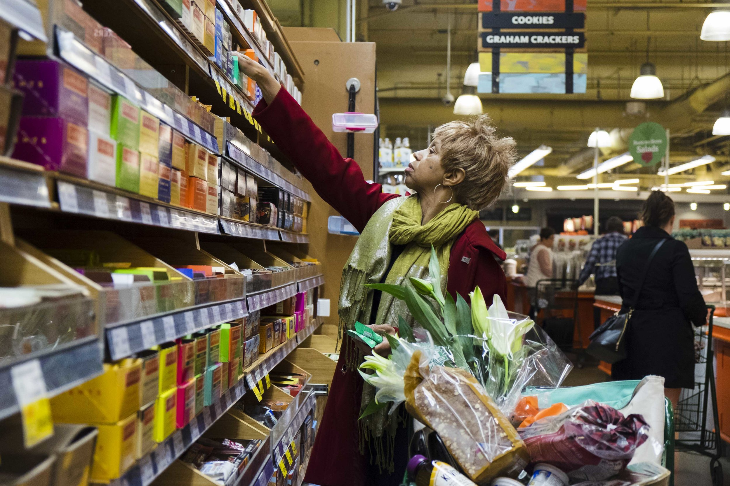 """Dianne Hodges, 69, shops at the Whole Foods in South Loop. Hodges, who lives in South Shore, said there are not enough resources in her neighborhood that keep older adults healthy. """"I never shopped in the community anyway because they had a Dominick's here for years and I never really shopped [there] because [it] was so different from the North Side…but I understood why it was different because it's not, they would try to bring in organic vegetables and things like that and they would just rot because the people were not, you know, were not buying them."""" Hodges, who teaches meditation and belly dancing, had a mini stroke and since then, she has """"had to work to reverse some things that would have caused me to be like most elders in my age group"""" through a healthy diet and lifestyle."""