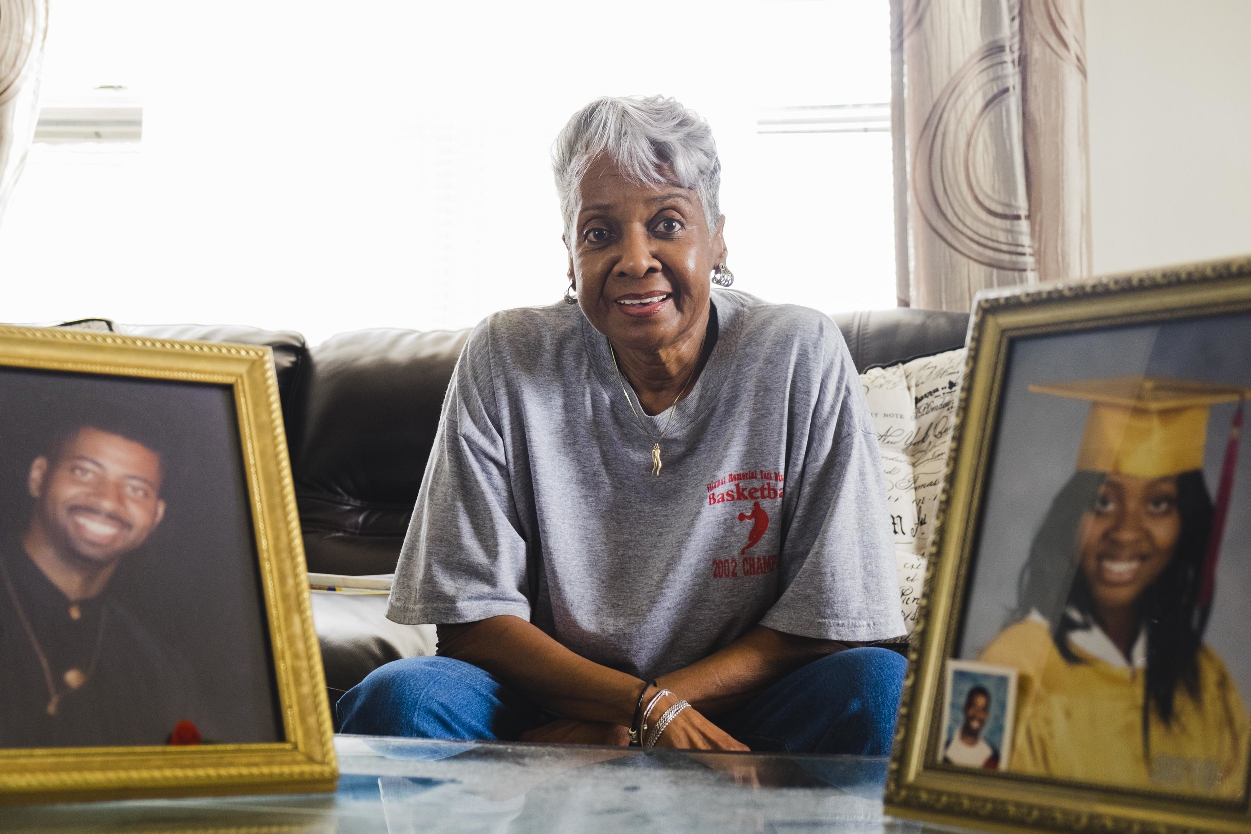 "Eva Early, 73, lives alone in a senior building in Auburn Gresham. A framed photo of her granddaughter and late son are displayed prominently on her living room's center table. The frames normally face the couch. ""they here with me so I could watch them and they watch me,"" said Early who said she is happy and content with her life even though she does not see her granddaughter often. ""I talk to them…I just look at the picture sometimes and I do, you know, wish he was here and then I look over there and say, there you are, you know. Hey granddaughter, you know…I know that if he was in here, he'd be seeing 'bout his momma, you know. That's it. That's what makes me serious, kinda old and sometimes lonesome. He's not here."""