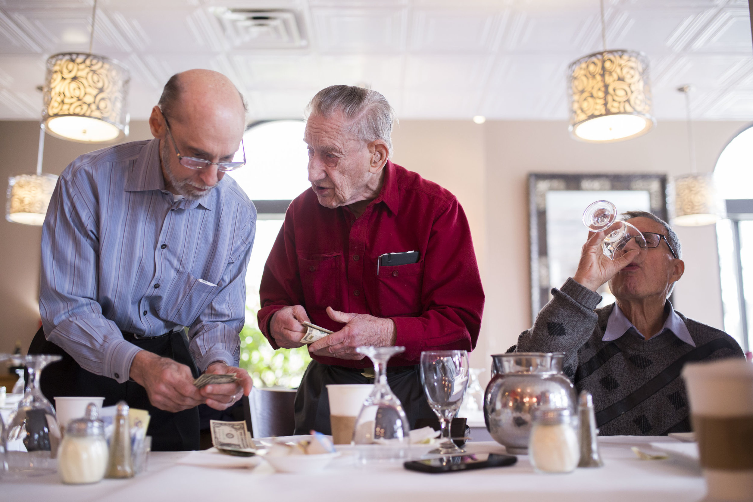 Jerry Gripshover and Sam Guard leave a tip at Piccolo Mondo in Hyde Park. Gripshover and Guard are part of a men's group composed of Hyde Park residents that meet at least twice a month to socialize. Social isolation among older adults is one of their biggest concerns.