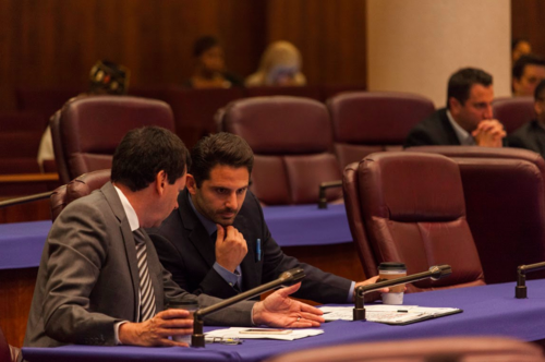 Chicago City Council members talking in chambers