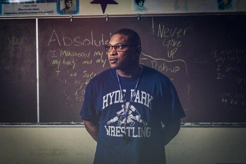Darren Wright standing in front of chalk board