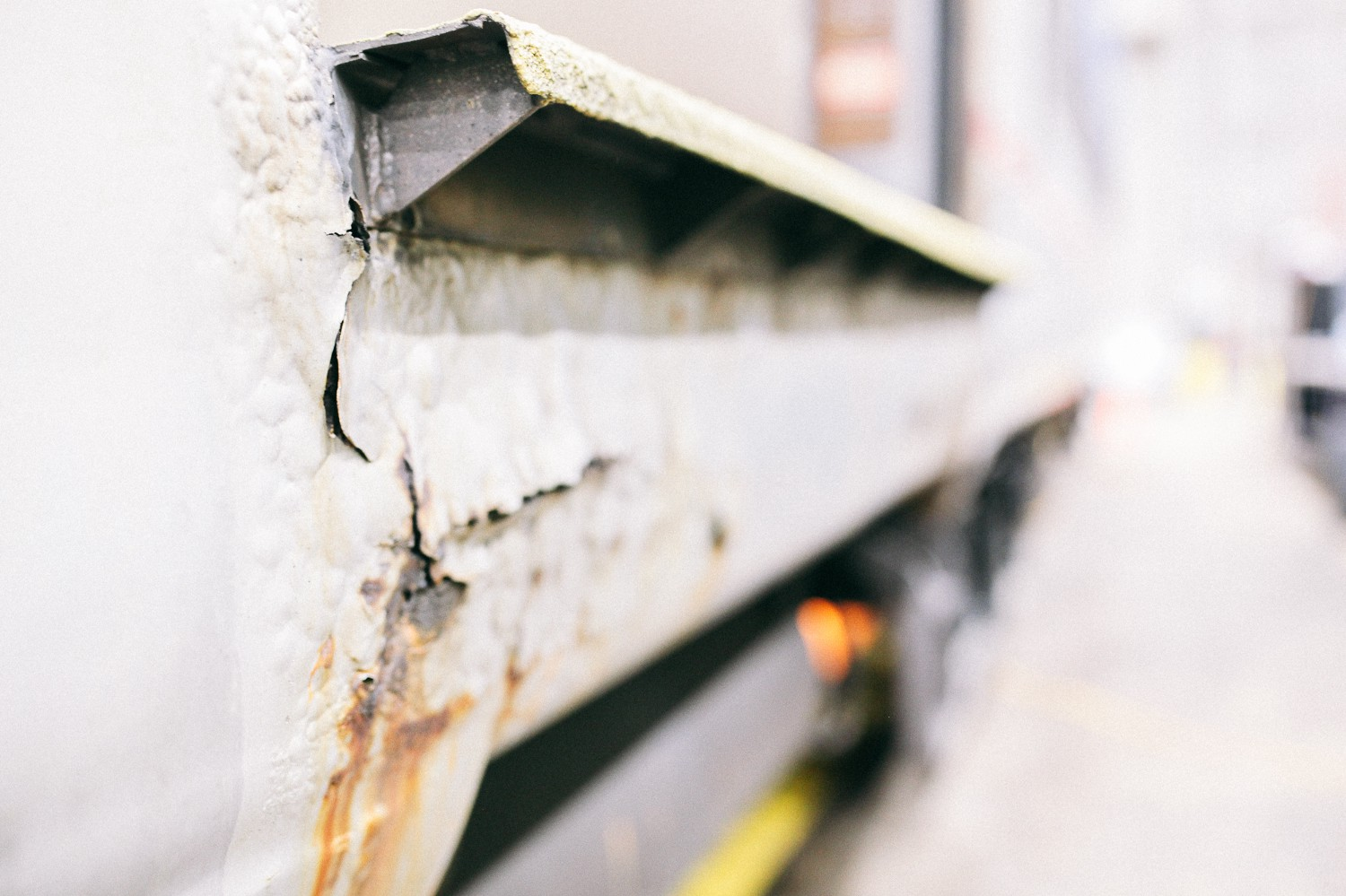 A close-up of rust on the exterior of an older railcar, which was made with carbon steel. This car was built in 1972. Modern cars are made with more durable stainless steel.