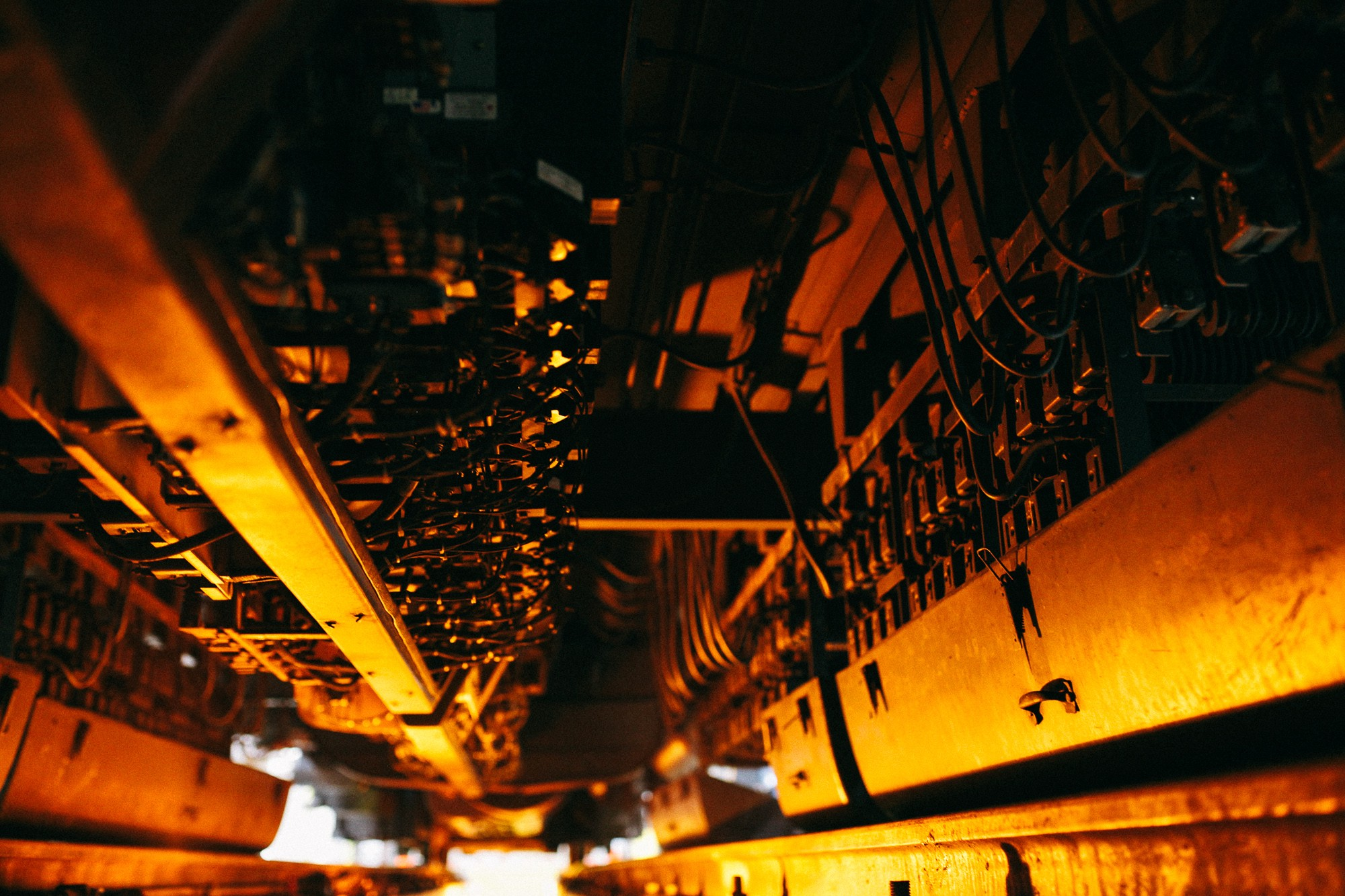The underbelly of a newer Metra car, a complex system of brakes and compressors.