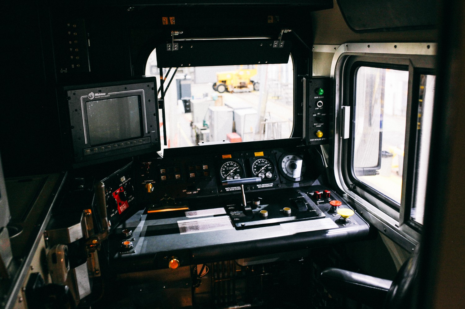 The interior of the conductor's seat of the newer cars on the Metra Electric, which sits higher than the cars from 1972. This means the conductors can see more of the rails in front of them.