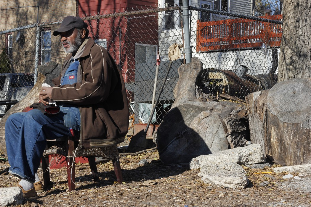 'Old Man Munchie' sits in one of the North Lawndale lots adopted by Men Making a Difference.