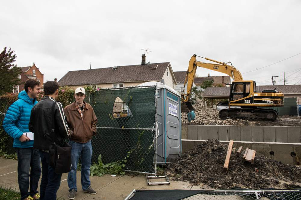 Curious City questioner Robert Beedle (right) with Jeremy Borden (middle) and WBEZ producer Jesse Dukes (front) facing a McKinley Park construction site near Robert's home. City Bureau photo by Manny Ramos.