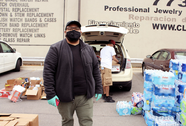 Edgar Flores is an organizer with Increase the Peace, an antiviolence group. (Photo: Alex Arriaga/City Bureau)