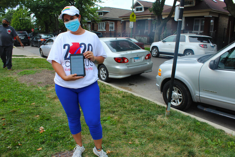 Maribel Sanchez, a volunteer with the Brighton Park Neighborhood Council, volunteered at a food distribution site before approaching people in line to count them in the census. (Photo: Alexandra Arriaga)