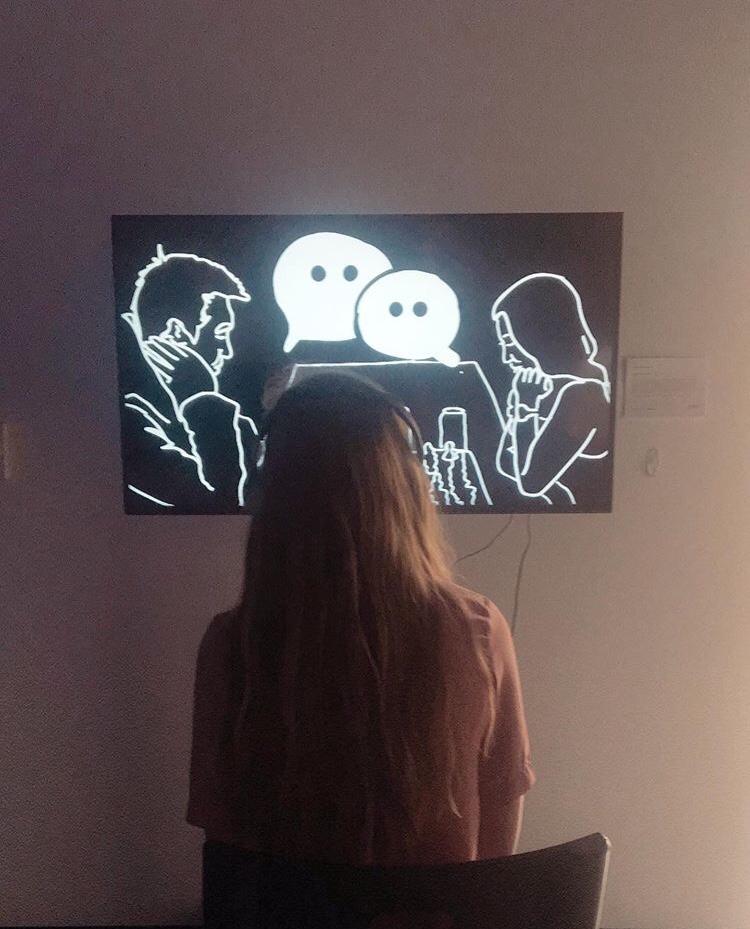 Photo of visitor listening to the story of Ashanti Hepzen