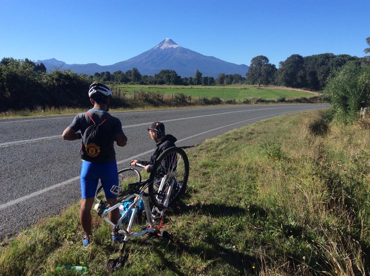 Fixing a local's puncture near Osorno Volcano, Chile