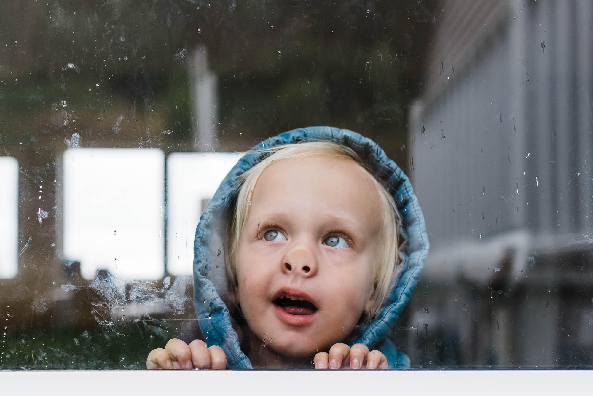 toddler-with-nose-pressed-up-against-window