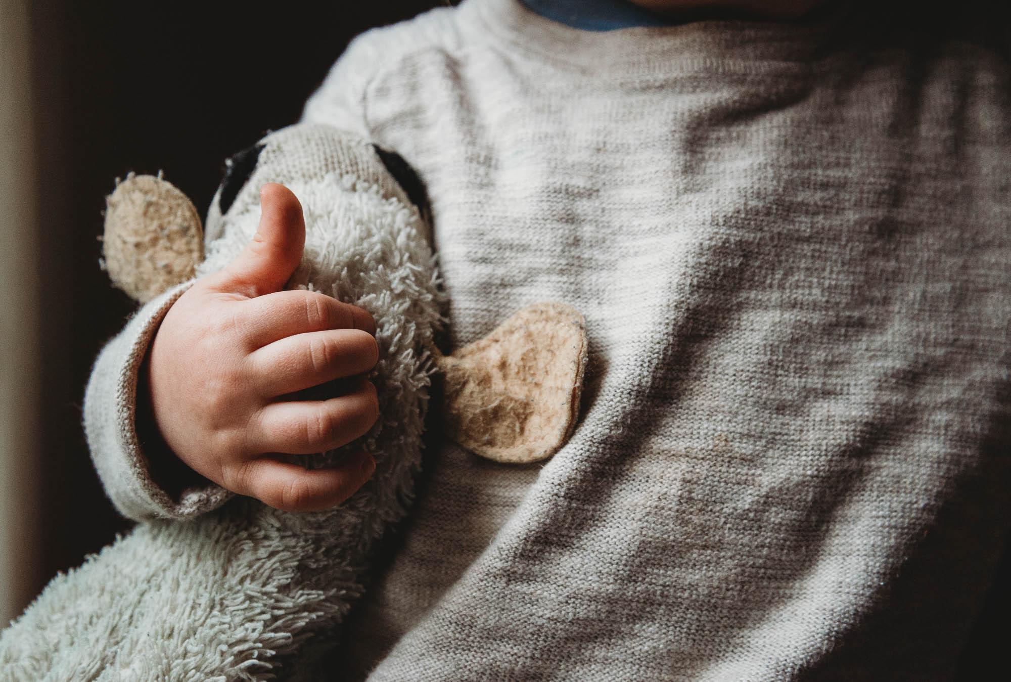 child-cuddling-soft-toy