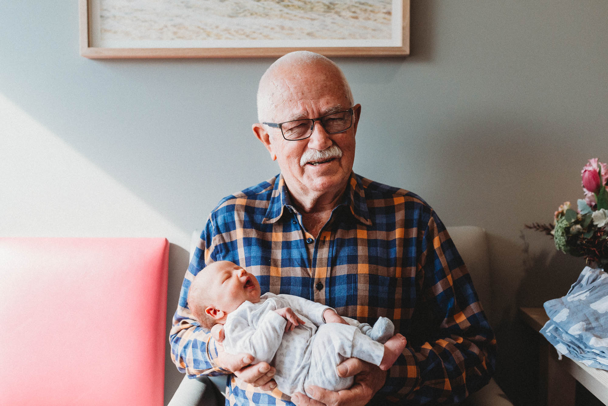 grandpa-holding-newborn-in-hospital-melbourne